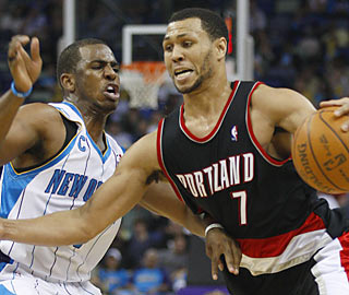 Brandon Roy (28 points) and the Blazers push Chris Paul's Hornets out of the playoff picture.  (AP)