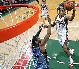 Brandon Jennings takes over late, scoring 11 of his 29 points in the fourth quarter and OT. (Getty Images)