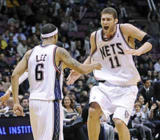The Nets can finally celebrate.  Their 10th win ensures they will not own the worst record ever. (AP)