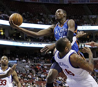 Kevin Durant does his usual work, collecting 26 points and 10 rebounds to overpower the 76ers.  (AP)
