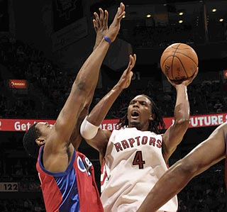 On a night when the Raptors shoot 61 percent, Chris Bosh does his part by going 12 for 17.  (Getty Images)