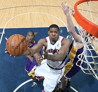 Joe Johnson does it himself here, but gladly accepts a big assist from Atlanta's bench.  (Getty Images)