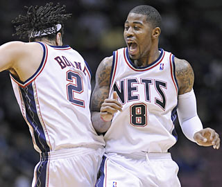 Terrence Williams (14 points, career-high 14 dimes), Josh Boone and the Nets finally have a little fun. (AP)