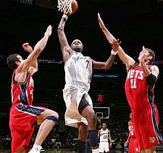 Andray Blatche has no problem splitting the Nets defense on his way to a big dunk. (Getty Images)