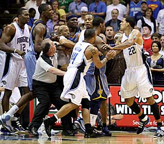 A scrum between Matt Barnes and Hasheem Thabeet escalates quickly on the court. (US Presswire)