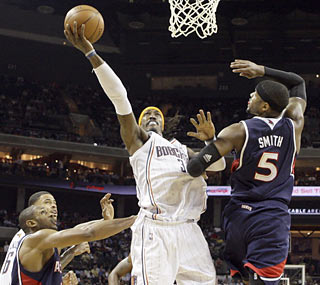 Gerald Wallace finishes with 28 points as the Bobcats move closer to their first playoff berth.  (AP)