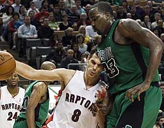Kendrick Perkins and the Celtics are too much for the short-handed Raptors to handle. (AP)