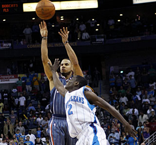 Darren Collison can't prevent D.J. Augustin from making this 3-pointer with 16 seconds left. (AP)