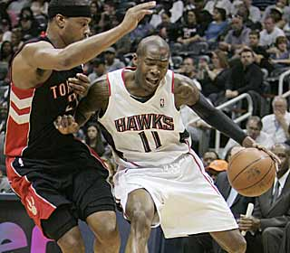 Tough play by Jamal Crawford and the Hawks, sees them reach the 50-win mark. (AP)