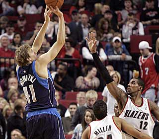Dirk Nowitzki caps off a big night by draining a 3-pointer late that seals the win for Dallas. (AP)