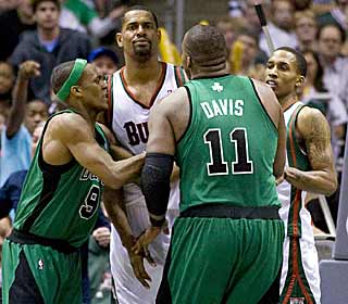 Celtics' Glen Davis takes offense after receiving a hard foul from the Buck's Kurt Thomas. (US Presswire)