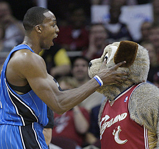 Dwight Howard and Cavs mascot Moondog have a little fun in what turns into a glorified exhibition.  (AP)