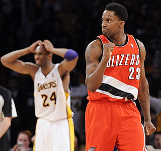 Kobe Bryant isn't as happy as Martell Webster after the Blazer draws a three-shot foul with 3.1 to go.  (AP)