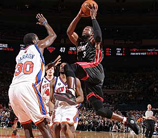 Dwyane Wade leads the Heat with 32 points as they do their best to keep pace in the East. (Getty Images)