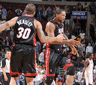 Michael Beasley congratulates Udonis Haslem, who buries another clutch shot for the Heat.  (Getty Images)