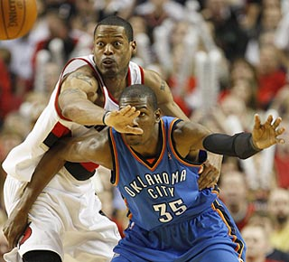 Marcus Camby tries his best to contain Kevin Durant. Both score 30 points, and Camby gets the victory.  (AP)