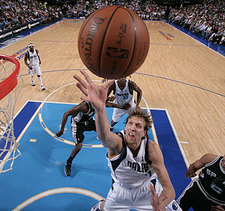 Dirk Nowitzki (19 points) and the Mavs take care of the Spurs -- but will see them again soon.  (Getty Images)