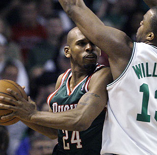 Jerry Stackhouse, who scores 17 points in the victory, bodies up against Shelden Williams.  (AP)