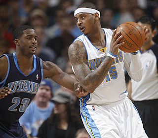 The Jazz don't have an answer for Carmelo Anthony, who explodes for a career-high 42 points.  (AP)