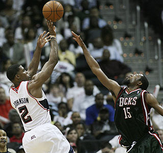 Joe Johnson shoots over John Salmons for two of his game-high 27 points for the Hawks.  (AP)