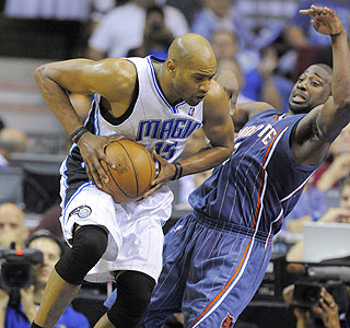 Vince Carter, who leads the Magic with 19 points, drives to the hoop vs. the Bobcats.  (US Presswire)