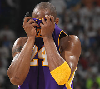Kobe (12 points) can't hide the fact that his Lakers return to L.A. on a two-game skid. (Getty Images)