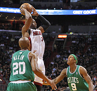 There isn't much Boston's Ray Allen and Rajon Rondo can do to slow down Dwyane Wade.  (AP)