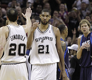 Manu Ginobili and Tim Duncan leave Dirk Nowitzki wondering what happened after Game 6.  (AP)