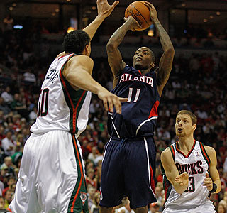 Jamal Crawford, who leads the Hawks with 24 points, shoots over Dan Gadzuric.  (Getty Images)