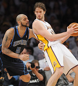 Pau Gasol's size advantage will be tough for Carlos Boozer to combat. (Getty Images)