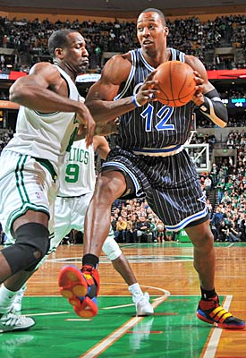 Big guys Kendrick Perkins and Dwight Howard are known to find foul trouble. (Getty Images)