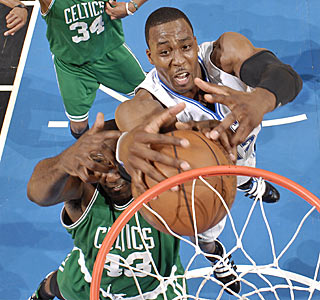The Celtics' post D frustrates Dwight Howard, who is held to 13 points and 12 rebounds.  (Getty Images)