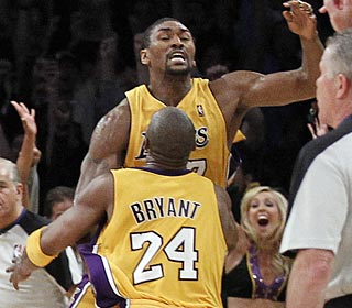 Kobe Bryant is thrilled after Ron Artest puts back Kobe's way-too-short 3 attempt.  (AP)