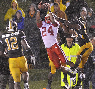 Nebraska's Niles Paul snags one of his two fourth-quarter TDs in the harsh conditions.  (US Presswire)