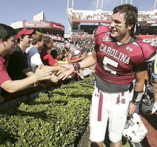 Stephen Garcia celebrates with the Gamecocks faithful after throwing for three touchdowns.  (AP)