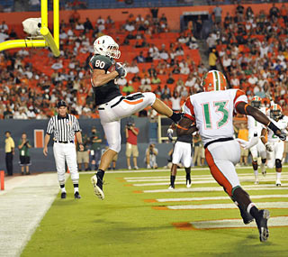 Tight end Jimmy Graham gives the Hurricanes a 17-3 lead with this TD catch in the first.  (US Presswire)