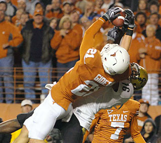 Safety Blake Gideon intercepts a Cody Hawkins pass to help Texas' defense muzzle Colorado.  (US Presswire)