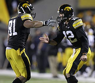 Iowa's Tony Moeaki, left, greets QB Ricky Stanzi after the two connected for a 42-yard TD.  (AP)