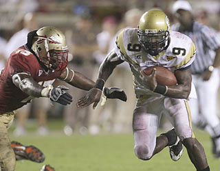 The Seminoles can't figure out how to stop QB Josh Nesbitt, who finishes up with four total TDs.  (AP)