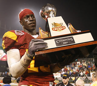 Emerald Bowl MVP Damian Williams (12 catches, 189 yards) earns the right to hoist the winner's trophy.