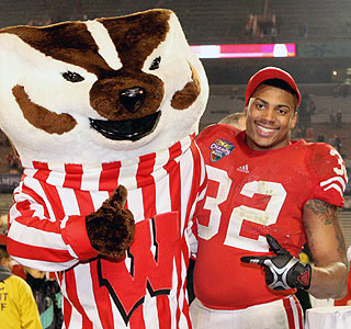 Bucky the Badger and John Clay (121 yards rushing, two TDs) celebrate the victory in Orlando.