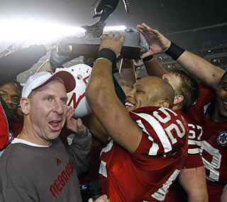 Bo Pelini's Huskers not only get the right to hoist the Holiday Bowl trophy, they do it in historic fashion.  (AP)