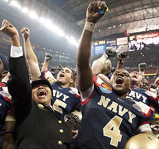 Ricky Dobbs, named the Texas Bowl MVP, helps Navy rush for 385 yards against Missouri.  (AP)