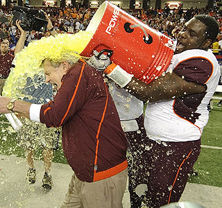 Here coach, have a drink: Virginia Tech's Frank Beamer is doused after the Chick-fil-A Bowl win.