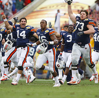 It's finally time to celebrate: Auburn players rush the field following the Outback Bowl win in overtime.