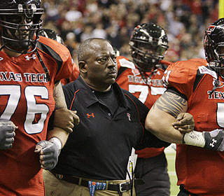 Interim head coach Ruffin McNeill puts on a strong face as he leads Texas Tech in the game.