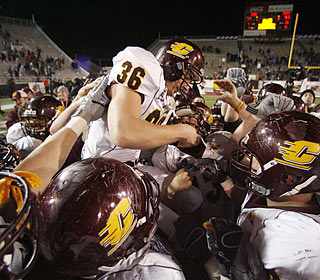 Andrew Aguila receives a big Chippewas lift after kicking the game-winning field goal.  (AP)
