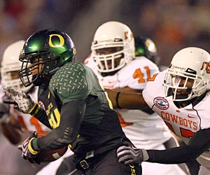 Oregon and Oklahoma State in the same conference? Not much in common besides the 'O'. (Getty Images)