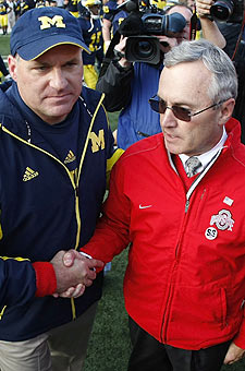 Rich Rodriguez and Jim Tressel could see each other twice a year on the field. (Getty Images)