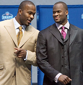 Most wanted the Texans to draft hometown favorite Vince Young (right) or Reggie Bush over Mario Williams (left). (Getty Images)